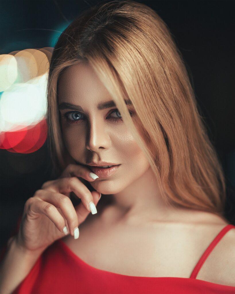 Nail salon-woman-biting-her-nails-2878329
